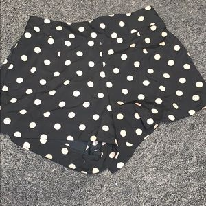 Black shorts with blush polka dots